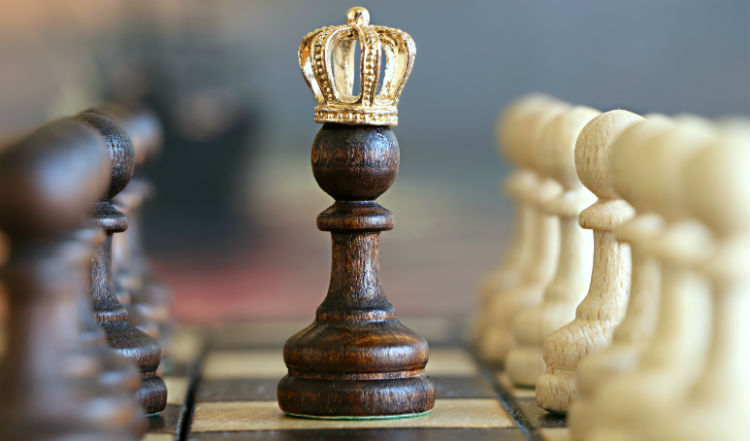 A Chess Pawn With A Crown