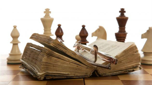 Chess Set With A Book On It