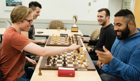 Two teams of two players each face off over two separate chess boards - Bughouse Chess