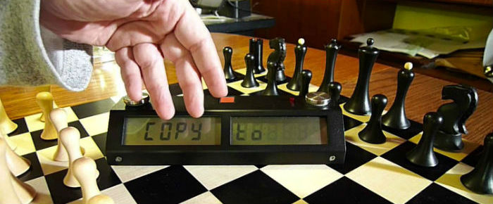 Chronos Chess Clock With A Chess Set
