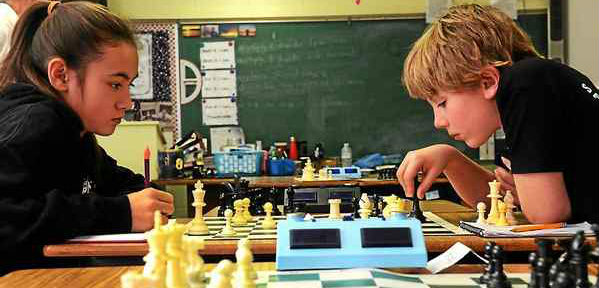 Two Kids Playing Chess With Digital Chess Clock