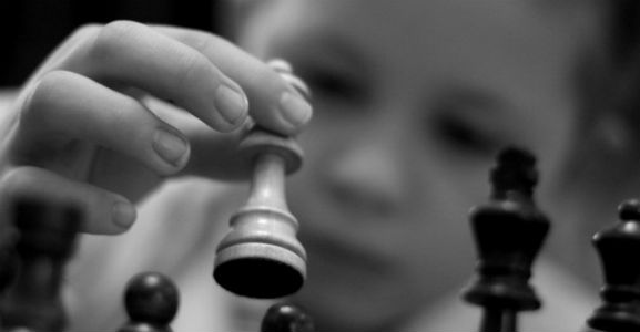 A Kid Playing Chess Black&White