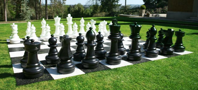 The Rolly Toys Giant Chess Set In A Backyard