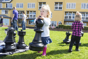 A Little Girl Is Playing Chess With The Rolly Toys Giant Chess Set