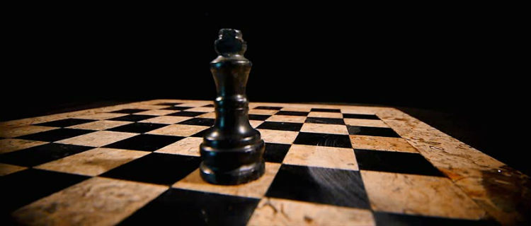 A Chess Piece On A Chess Board