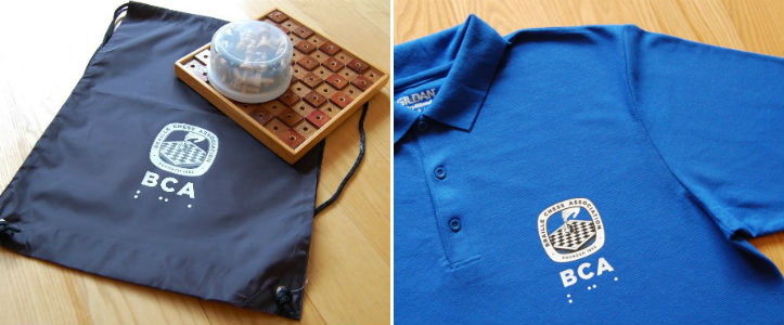 Polo shirts and tote bags with the BCA logo.