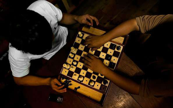Two Blind Chess Players Playing Chess on a Braille Chess Set