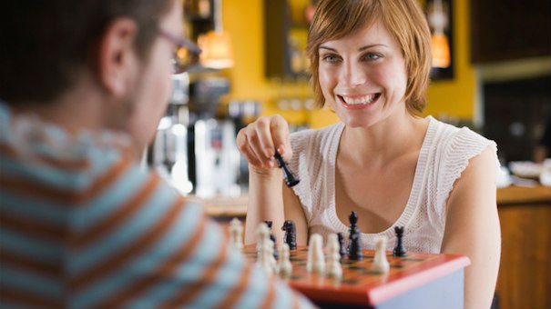 Two Adults Playing Chess