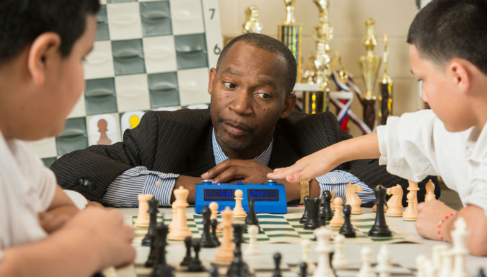 A Chess Teacher and His Students