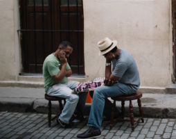 Two Men Playing Chess In Havana, Cuba