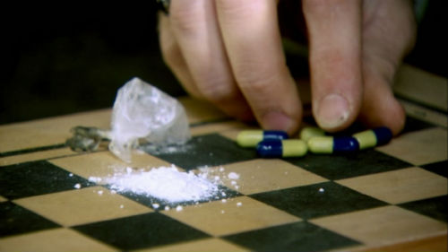 Drug pills on a chess board