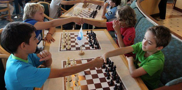 Kids Playing Chess In A Chess Tournament For Kids