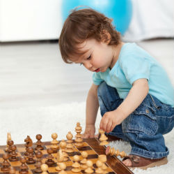 A Yound Kid Playing Chess