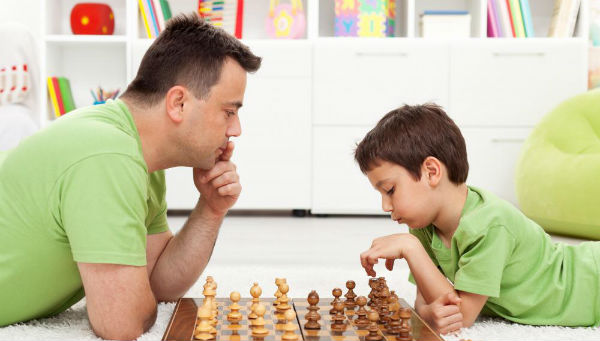 A Dad and His Son Playing Chess