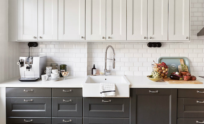 White upper cabinets with black lower cabinets.