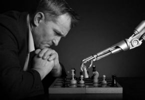 A Man Playes Chess Against A Robot