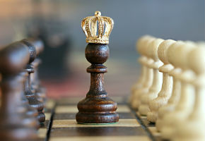 A Chess Pawn Pieces With A Crown