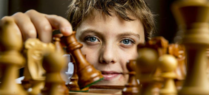 A Child Playing Chess