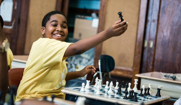A happy student in a chess school