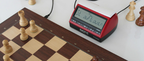 The DGT PI Digital Chess Clock with a DGT E-Board