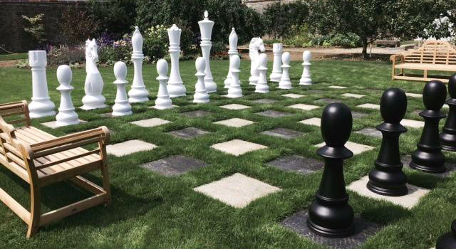 MegaChess Fiberglass Giant Chess Set in a Yard