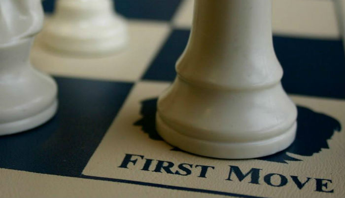 First Move Logo on a Chessboard