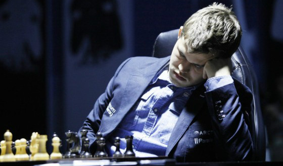 Margnus Carlsen falling asleep during a chess match