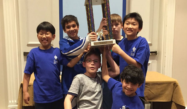 NSCF Students with their trophy after winning in a chess tournament