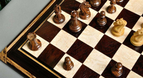 The African Palisander / Bird's Eye Maple with a matching chess piece set