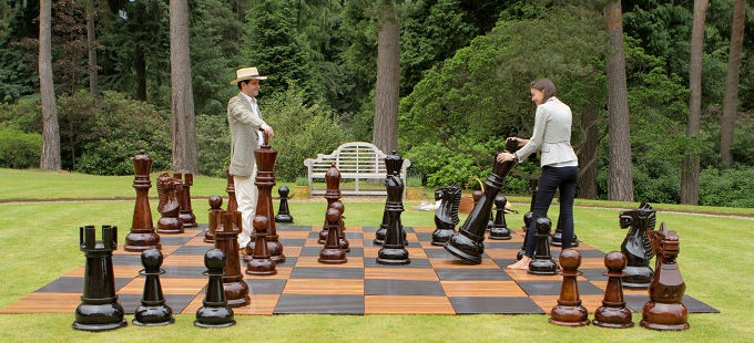 MegaChess Teak Giant Chess Set in a Garden