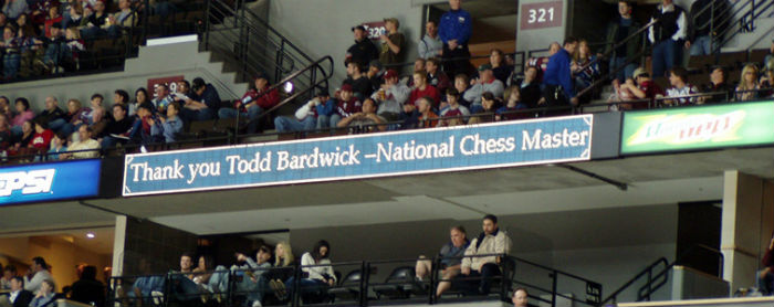 A sign in honor of Todd at the Pepsi Center where he has taught chess to thousands of people